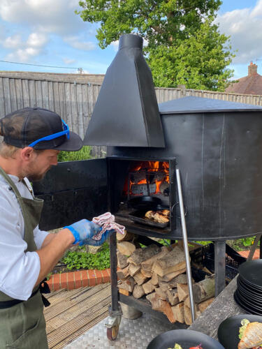 Commercial pizza oven with chef